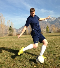 Cam Cameron playing soccer.