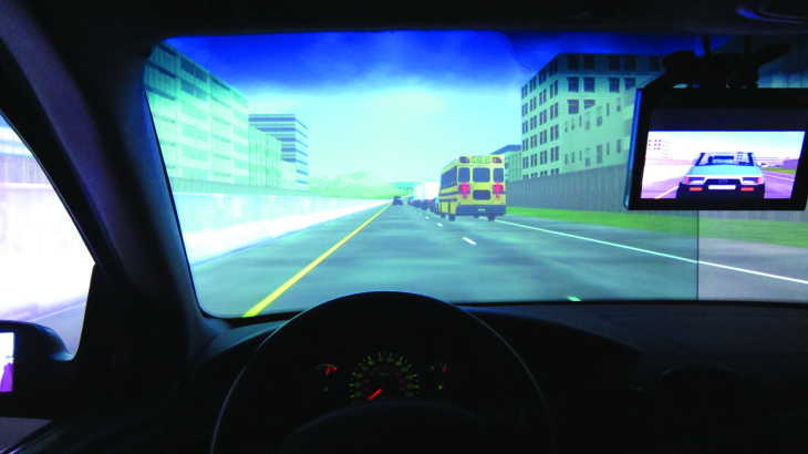 U student researches distracted driving using a simulator.