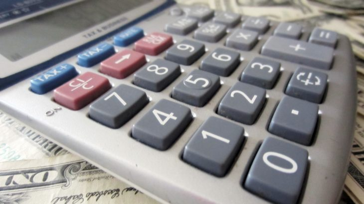 """""""Calculator and Money"""" by 401(K) 2012 via Flickr"""